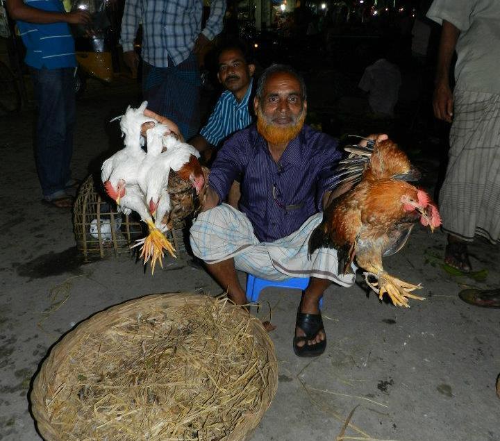 A chicken vendor in Bangladesh