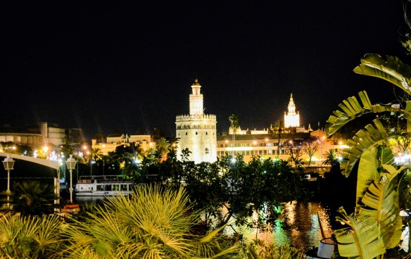 View on river Guadalquivir and Torre de Oro from Triana, Seville at night