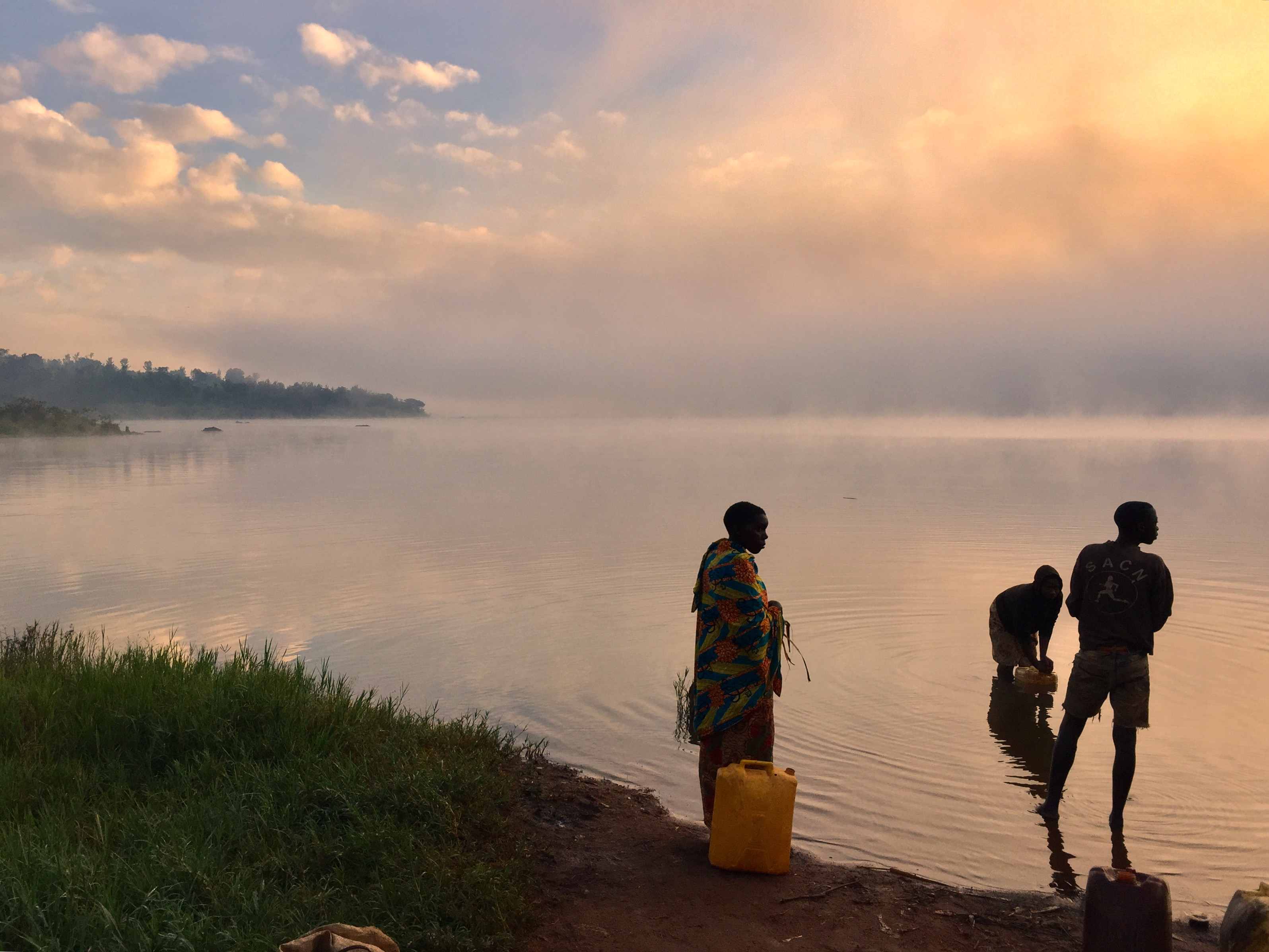 People getting water at Lac Rwihinda, Kirundo - Burundi Travel Blog